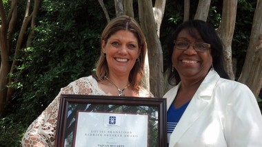 Tajuan McCarty, left, received the 2015 Louise Branscomb Barrier Breaker Award, named for the late United Methodist physician. McCarty is a member of Christ United Methodist Church in Shelby County. Eula Thompson, right, chairwoman of the Commission on the Status and Role of Women, presented the award.