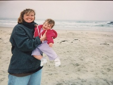 Isabel and I on the Rhode Island beach in the mist. Despite the smile, I was miserable.