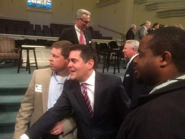 The Rev. Russell Moore, center, president of the Ethics and Religious Liberty Commission of the Southern Baptist Convention, shakes hands with people during a break at The Church and Sexuality Conference, Monday, Feb. 29, 2016, at First Baptist Church of Montgomery.
