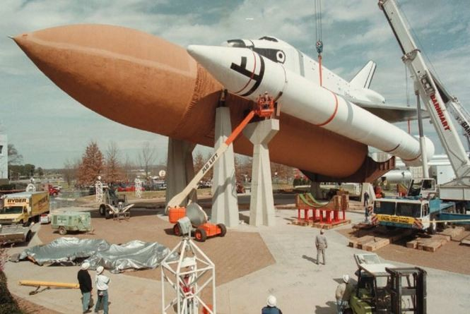 Workers remove one of two solid rocket boosters from the space shuttle orbiter Pathfinder display at Huntsville's U.S. Space and Rocket Center in 1999. The booster rockets were needed as spares for ongoing shuttle missions. The center, which celebrates Alabama's contributions to spaceflight, opened in 1970 and has had more than 16 million visitors. (Dave Dieter, The Huntsville Times/Alabama Media Group/AL.com)
