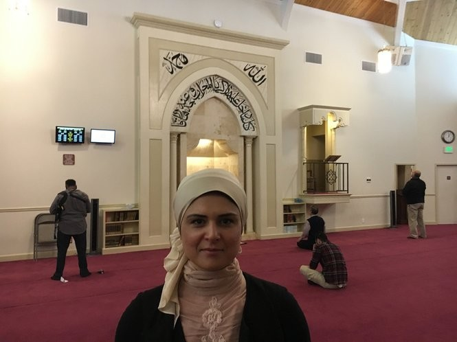 Khaula Hadeed meets with a reporter as people begin to gather for Friday prayers at the Hoover Crescent Islamic Center.