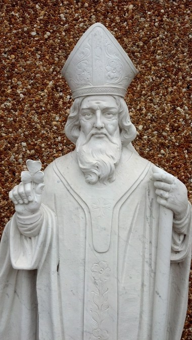 There is a statue of St. Patrick holding a shamrock in front of St. Patrick's Catholic Church in Adamsville.