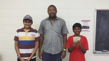 Very proud tournament prize winners: Kapil Nathan and Sai Korapatti with tournament director Caesar Lawrence. The recent Chris Bond Memorial Tournament was recently held in Montgomery with Stephen Graveling winning the Champion's trophy. (Photo: Archana Nathan)