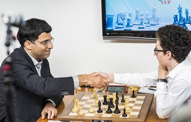 Former world champion Vishy Anand receiving congratulations from American Grandmaster Fabiano Caruana who had just resigned the game during the recent Sinquefield Cup. Anand played a brilliant game against Caruana in Round Five of the tournament which featured a dazzling display of tactics. (Photo: GrandChessTour)