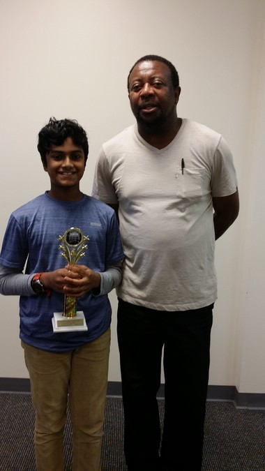 Birmingham Challenge Rook Section first place winner Omvrisha Gopurala with tournament director and chess coach Caesar Lawrence. Omvrisha is a student at Advent School where he plays in their chess club and is in the ChessKidsNation coaching program. (Photo: Caesar Lawrence)