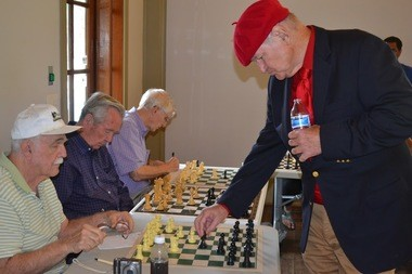 Skip Galyean, Frank Bubel, and Jim McKittrick matched their skill against Jude Acers. The three take part in a chess program for older adults sponsored by ChessKidsNation at the Hoover Senior Center. Chess is considered a healthy aging, 'brain game' that can help memory, cognitive skills, and potentially minimize the risks of dementia. (Photo: Balagee Govindan)