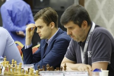 Russian Grandmaster Maxim Matlakov (next to his team member GM Peter Svidler) quickly demolished a fellow grandmaster in a spirited attack during the recent European Club Cup Championship. (Photo: Gurkan Ergun)