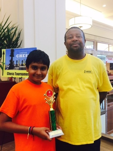 Chess Day tournament winner Kapil Nathan with tournament organizer and director Caesar Lawrence. Nathan won the top section with a perfect 5-0 score. Nathan is in the ChessKidsNation coaching program. Caesar Lawrence has been hosting Alabama's National Chess Day scholastic tournaments since 2010. He partners with Children's of Alabama so that all the proceeds from the tournament are donated to the hospital for their programs.