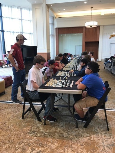 Pell City High School chess coach Nash Kreitlein watches his team members play at the National Chess Day tournament which was held on October 14. (Photo: Ann Kreitlein and Caesar Lawrence)