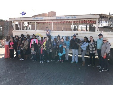 Participants posed in front of a duck boat before their tour on Jan. 20. (Photo courtesy Gulf Coast Ducks)