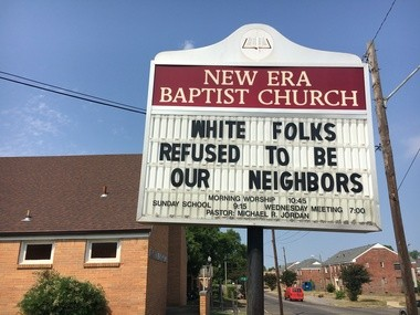 Rev. Michael R. Jordan posted messages on both sides of the New Era Baptist Church sign.