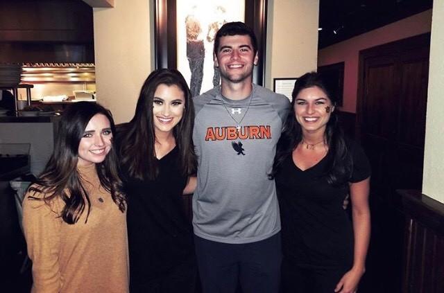 Laiken Baumgartner (second from left) poses with former Auburn University quarterback Jarrett Stidham.