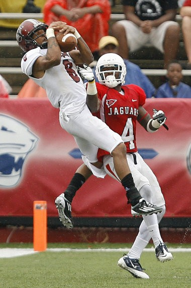 Troy wide receiver Chip Reeves (8) catches a pass in the second quarter over South Alabama cornerback Darrius Morrow (4) Saturday, Sept. 29, 2012, at Ladd-Peebles Stadium in Mobile, Ala. (Press-Register/Mike Kittrell)