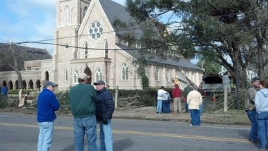 Church members gather to survey the damage at Trinity Episcopal in Mobile. (Carol McPhail/cmcphail@al.com)
