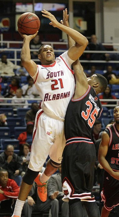 South Alabama forward Augustine Rubit (21) shoots over Arkansas State guard Raeford Worsham (35) during the first half of a Sun Belt Conference college basketball game Saturday, Dec. 29, 2012, at the Mitchell Center in Mobile, Ala. (Mike Kittrell/mkittrell@al.com)