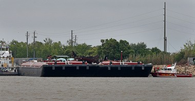 The fuel barge involved in the Wednesday, April 24, explosion on Mobile Bay in Mobile, Ala., is pictured on Thursday, April 25, after the fire was extinguished. (Bill Starling/bstarling@al.com)