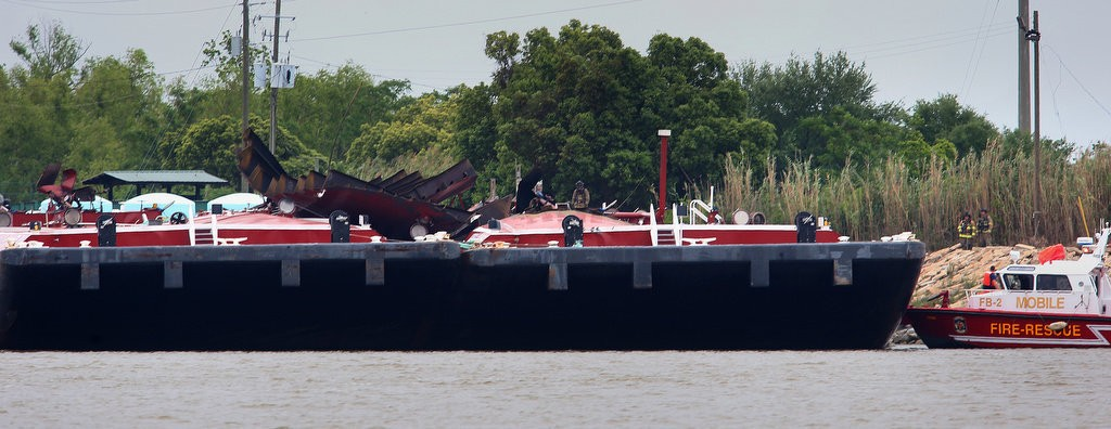 A fuel barge involved in the Wednesday, April 24, explosion on Mobile River is pictured on Thursday, April 25, after the fire was extinguished. (Bill Starling/bstarling@al.com)
