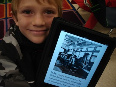 Elsanor School second grader Adam Cincotta, pictured, enjoys reading a book about Rosa Parks on his iPad. He is a student in Rhiannon Brackinâs class. (Submitted by Linda Hankins)