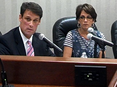 Hoover schools Superintendent Andy Craig talks about communities that could be affected by the redrawing of school attendance zones in the 2015-16 school year during a Hoover school board meeting on Monday, Aug. 4, 2014, as school board President Donna Frazier listens. (Jon Anderson/janderson@al.com)