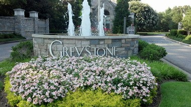 The entrance to the Greystone subdivision, one of the more affluent areas of Hoover, Ala., is decorated with flowers and a fountain and monitored by a security guard. (Jon Anderson/janderson@al.com)