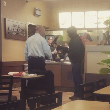 Andrea Stoker captured this image of Chick-fil-A owner/operator Mark Meadows helping a man in need, Wednesday, January 7, 2015. (Andrea Stoker)