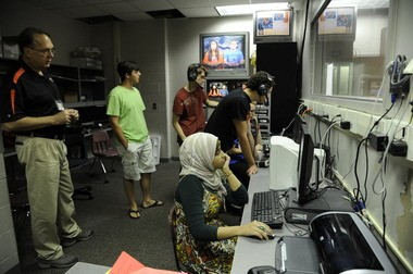 Hoda Muthana, seated in the foreground, participates in a broadcasting class at Hoover High School in Hoover, Ala., on Aug. 18, 2011. (Beverly Taylor/The Birmingham News)