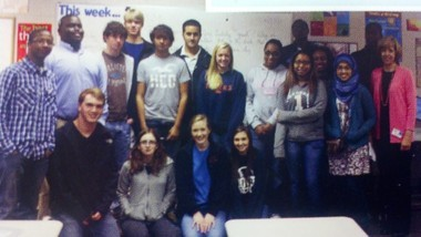 Hoda Muthana, at right in the head scarf, poses for a photo with her 11th-grade English class at Hoover High School in Hoover, Ala. (Photo from 2012 Hoover High School yearbook)