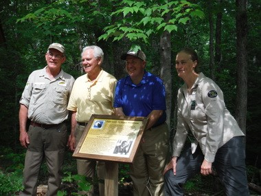 Wild South staffers gathered at the Sipsey Wilderness Sunday, May 17, 2015, with former Congressman Ronnie Flippo, second from left, to mark the 40th anniversary of the Sipsey Wilderness and dedicate a plaque to Flippo, who helped pass the expansion of the wilderness in 1988. (Photo courtesy of John Northrup)