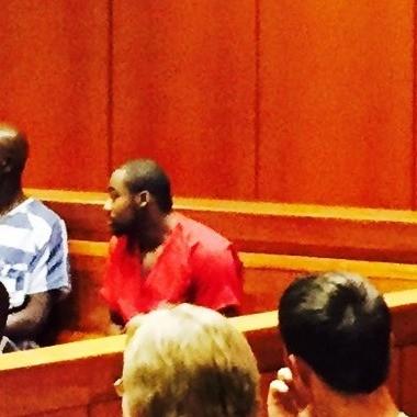 Janard Shamar Cunningham, in red jail uniform, sits in Jefferson County District Court Judge Shelly Watkins' courtroom on Aug. 11, 2015.