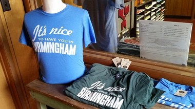Yellowhammer Creative was not the first to put the slogan on T-shirts, and not even the second.