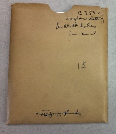 An envelope from the archives of The Birmingham News contains glass negatives showing scenes from the 1931 shooting of Jefferson County prison guard William Lee Taylor.