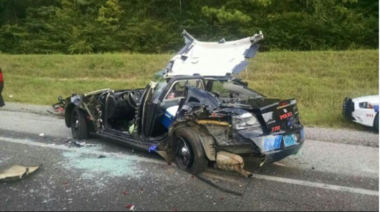 A Springville police officer was injured on I-59 when his car was struck from behind while firefighters were working a car fire.