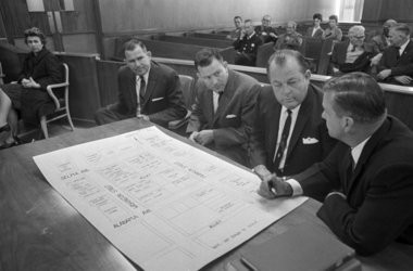 Stanley and Namon Hoggle and Elmer Cook, from left, and Robert Radford, investigator. N(AP Photo/Horace Cort, File)