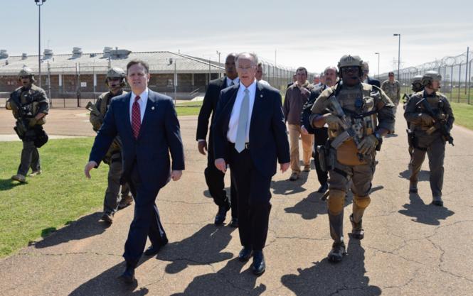 Alabama Gov. Robert Bentley (center) joins Alabama Department of Corrections Commissioner Jeff Dunn (center left) on a tour of Limestone Correctional Facility in Harvest, Alabama, April 4, 2016. (Bob Gathany/bgathany@AL.com)