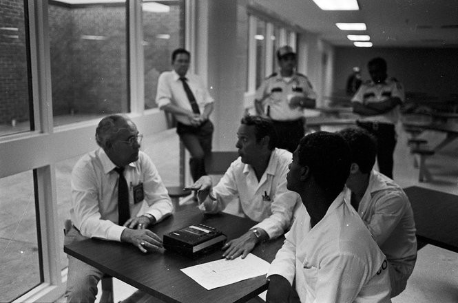 """Things get heated during hostage negotiations with inmate Kenneth """"Satch"""" Henley and Deputy Commissioner Charles D. Bryan, during riot at St. Clair Correctional Facility."""