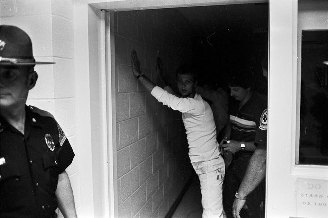 An unidentified inmate is frisked before being brought in to the secure side of the St. Clair Correctional Facility.