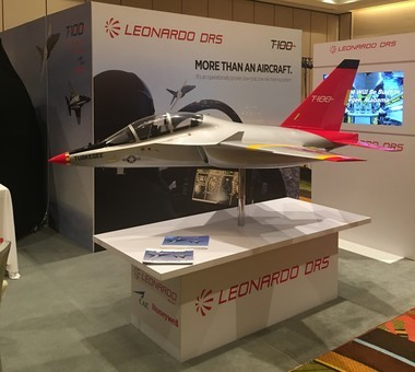 A model of the T-100 jet trainer with the trademark red tail of the Tuskegee Airmen on display at the national convention of the Airmen in Orlando.