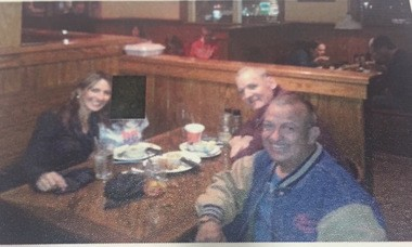 Akl and Charles Todd Henderson with a friend at a local restaurant. Minor child's face is blacked out (Contributed)