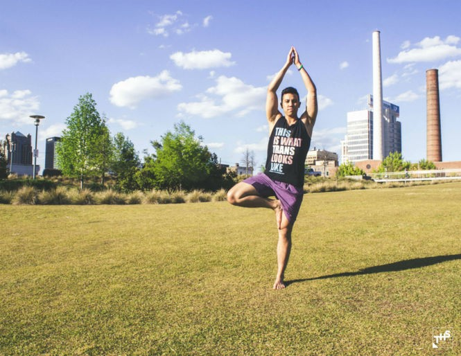Leucas Miller doing yoga poses at Railroad Park in Birmingham.