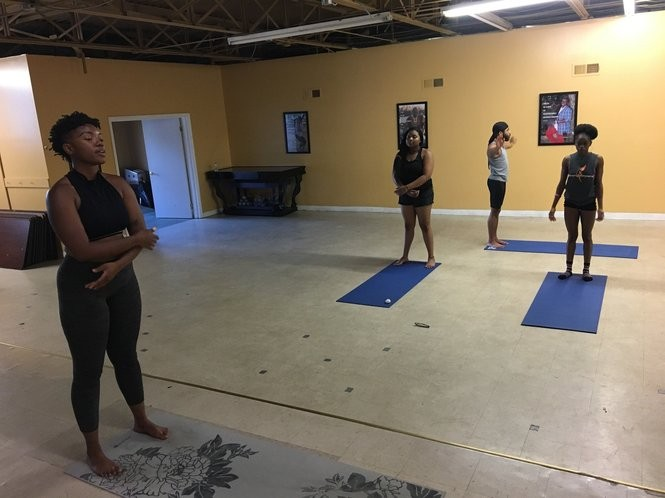Tori Wolfe-Sisson instructs the Trap Yoga class class hosted by BLK Pearl at The Hub in south Birmingham on June 19, 2018.