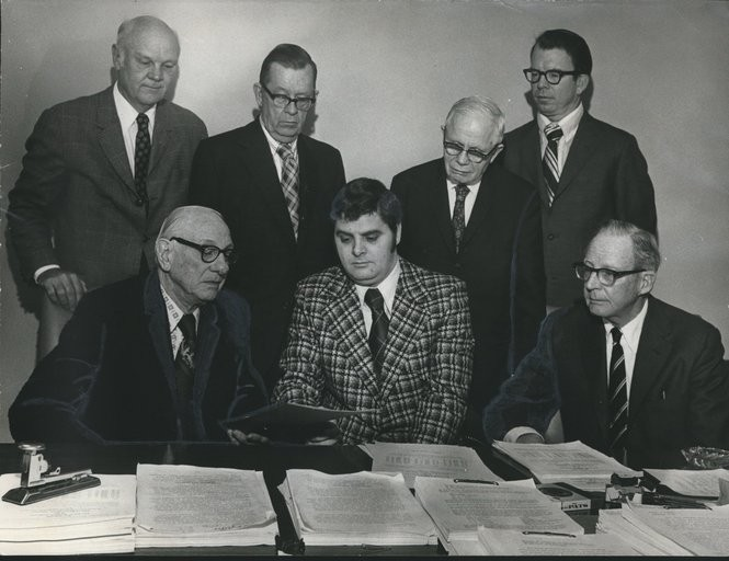 In 1973, Franklin Haney (center front) bought land in downtown Birmingham to develop an office tower to lease back to the Social Security Administration.