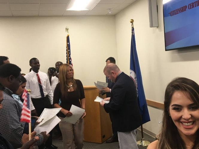 Ana Nunn, who immigrated into Alabama from Brazil in 1997, accepts her naturalization certificate during a ceremony at the United States Citizenship and Immigration Services Montgomery field office on Aug. 14, 2017. About 40 other applicants were naturalized that day.