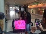 Kimberly Houzah poses with a supporter at Oxford's Quintard Mall Thursday, Dec. 8, 2016, after a demonstration outside Victoria's Secret.