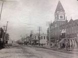 A period photograph shows downtown Gadsden and the Etowah County Courthouse.