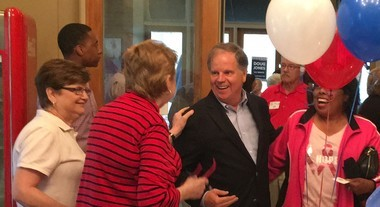 Doug Jones shakes hands with supporters in Anniston Tuesday, Nov. 7, 2017.