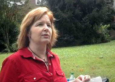 Terri Michal of Madison protests outside the Huntsville City Schools central office in October 2012. (File photo)