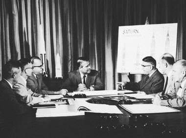 This 1961 photo from the Marshall Space Flight Center archives of Wernher von Braun and some of his key associates shows von Braun, center, looking at Dieter Grau as Grau makes a point. Also at the table, from left, Werner Kuers, Walter Haeussermann, W.A. Mrazek, Oswald Lange and E.W. Neubert. (NASA photo)
