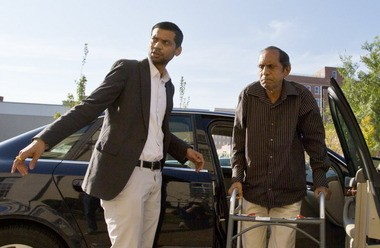 Chirag Patel and his father, Sureshbhai Patel, arrive at the federal courthouse in Huntsville on Sept. 1, 2015. (AP Photo/Brynn Anderson)
