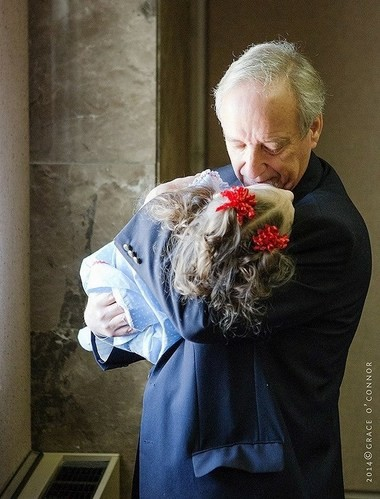 State Rep. Mike Ball holds Leni Young on the day Carly's Law passed the legislature in 2014. (Courtesy of Grace O'Connor/Grace O'Connor Photography)