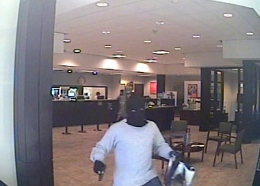 A man is seen fleeing following a robbery of the Regions Bank on U.S. 72 in Athens Thursday morning. Police are asking for help tracking down the suspect. (Athens Police Department)